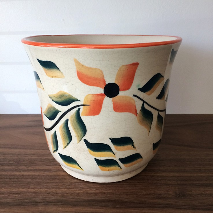 Round Planter with drainage hole; orange/green floral design. $40.00 by FLORAL/FOLIAGE PLANTERS
